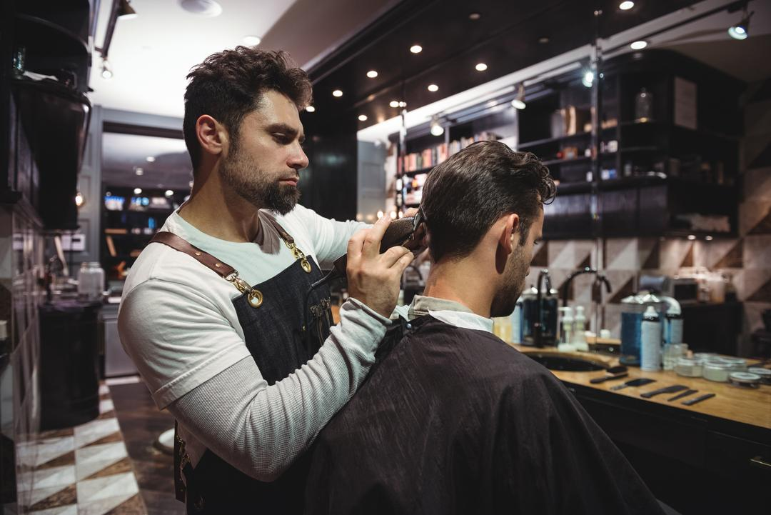 Man getting his hair trimmed with trimmer in barber shop Free Stock Images from PikWizard