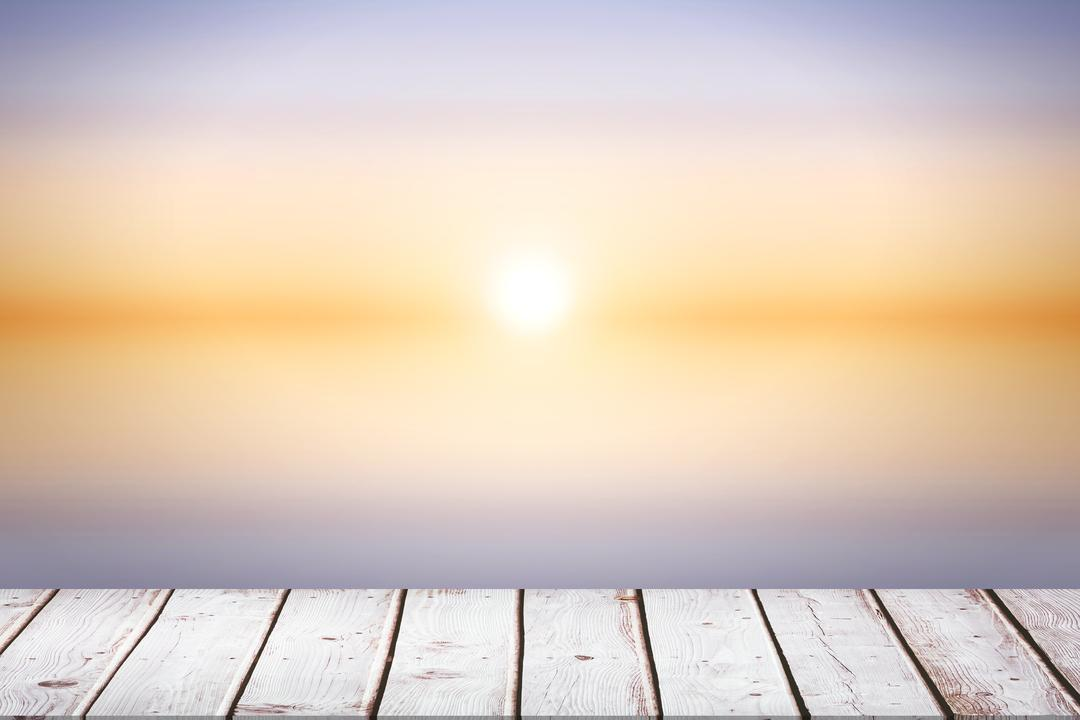 Digital composite of wooden boards with sunset background