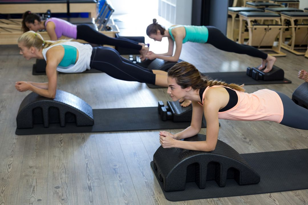 Group of women exercising on arc barrel in gym Free Stock Images from PikWizard