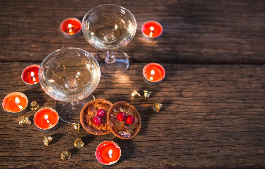 Wine glasses with christmas decorations on wooden table