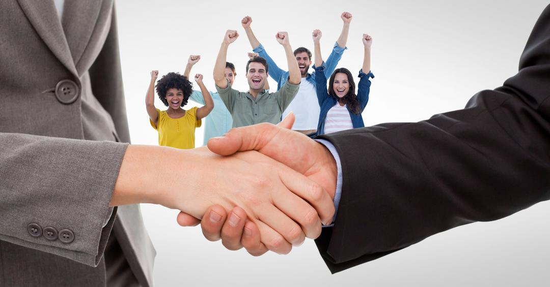 Cropped image of business people doing handshake with cheerful employees in background