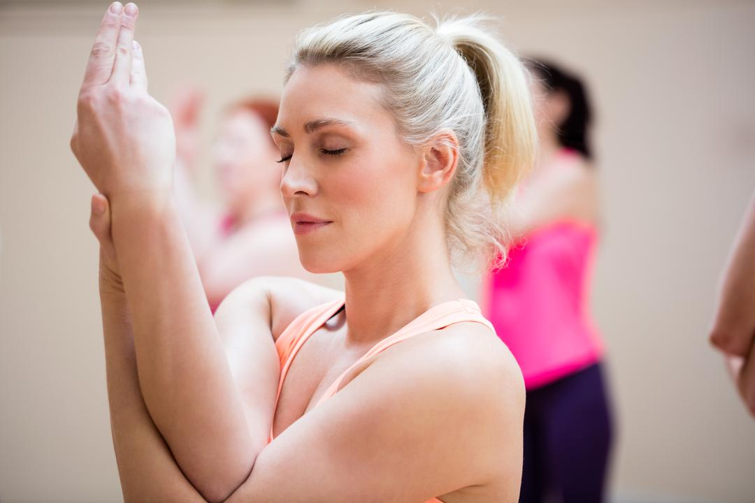 Woman performing hand exercise in the fitness studio