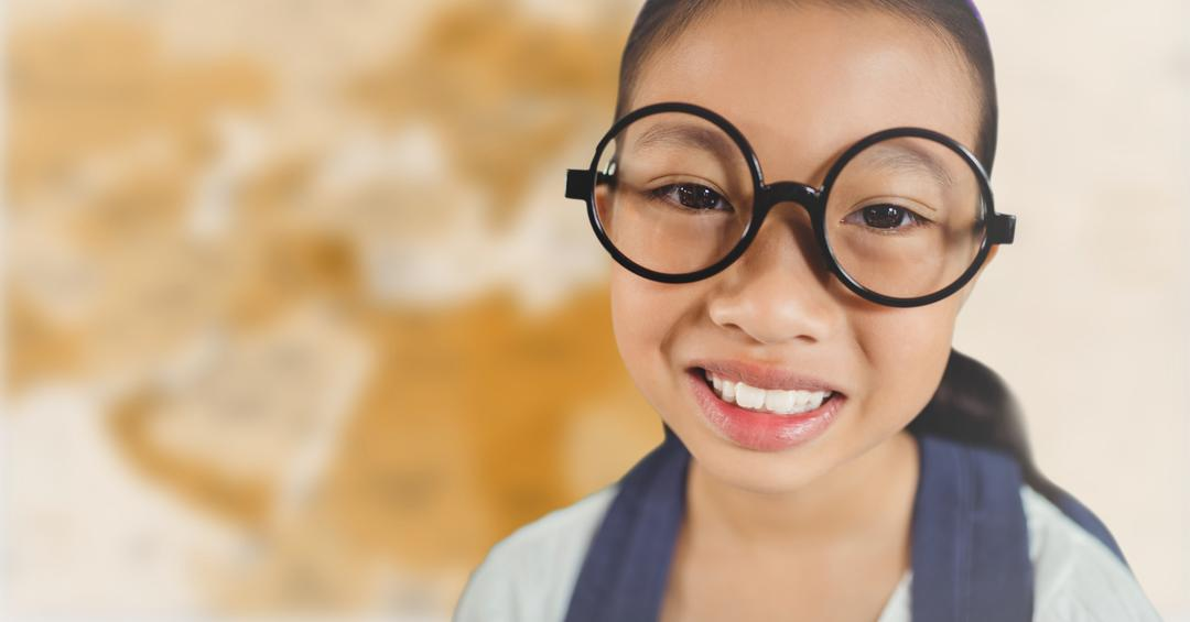 Digital composite of Girl with glasses smiling against blurry brown map Free Stock Images from PikWizard