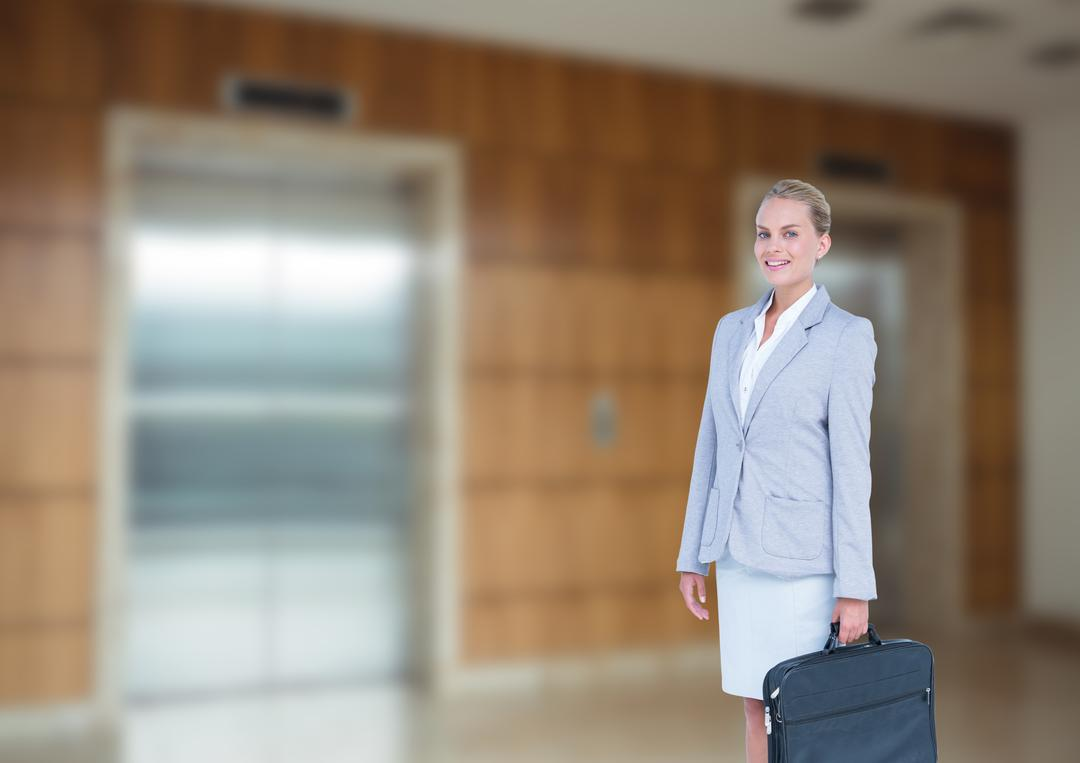 Business woman in front of elevator