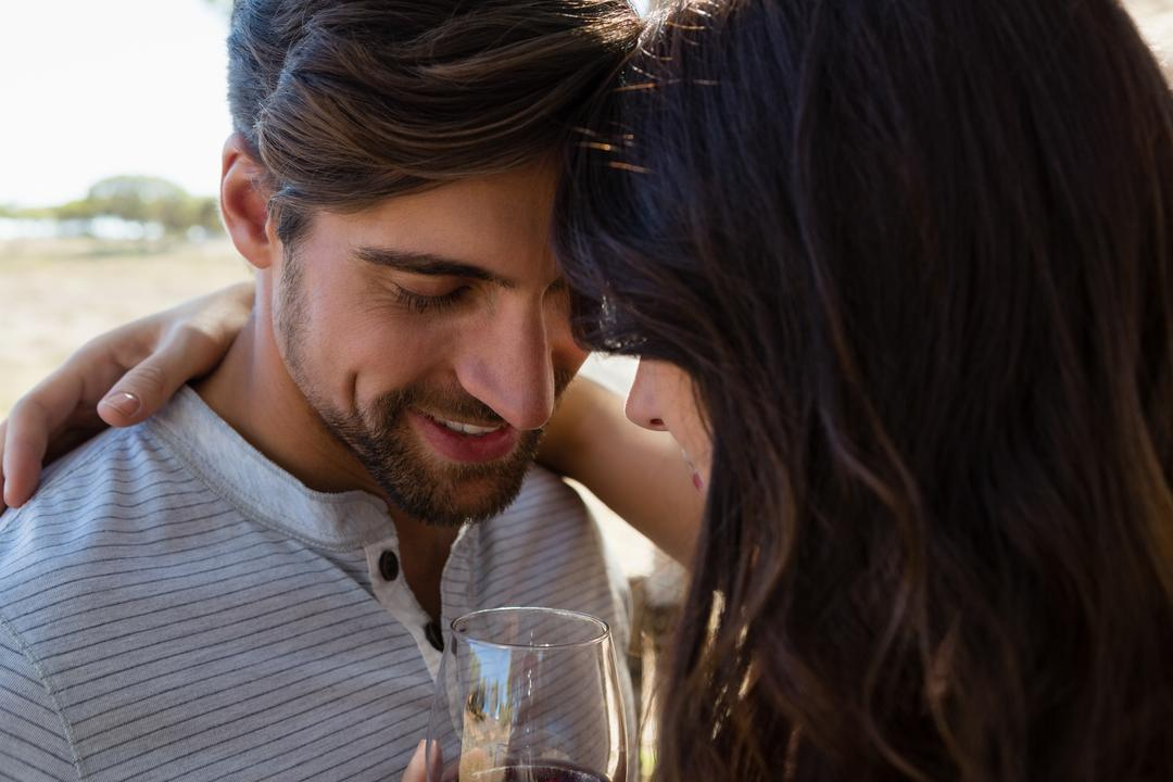 Close-up of romantic couple with wine