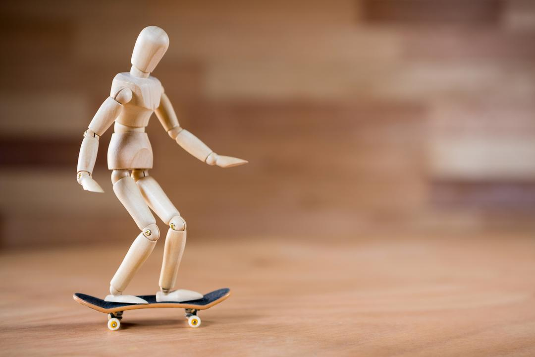 Conceptual image of figurine skateboarding on a wooden floor Free Stock Images from PikWizard