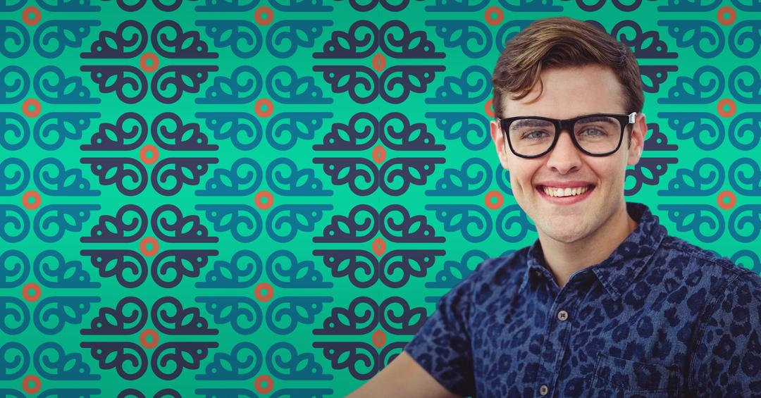 Man in glasses against pattern and teal background