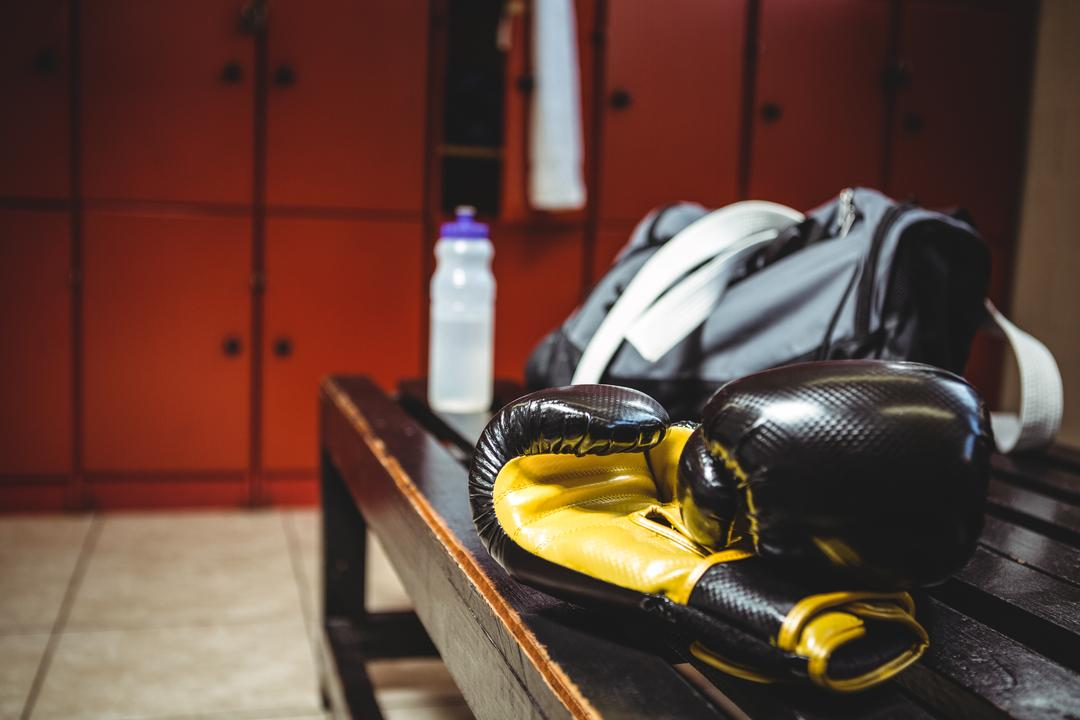 Close-up of boxing gloves on bench in locker room