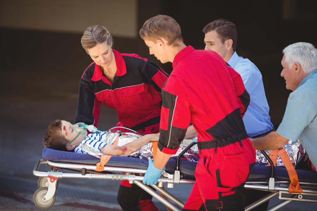 Paramedics rushing a patient in emergency on street Free Stock Images from PikWizard