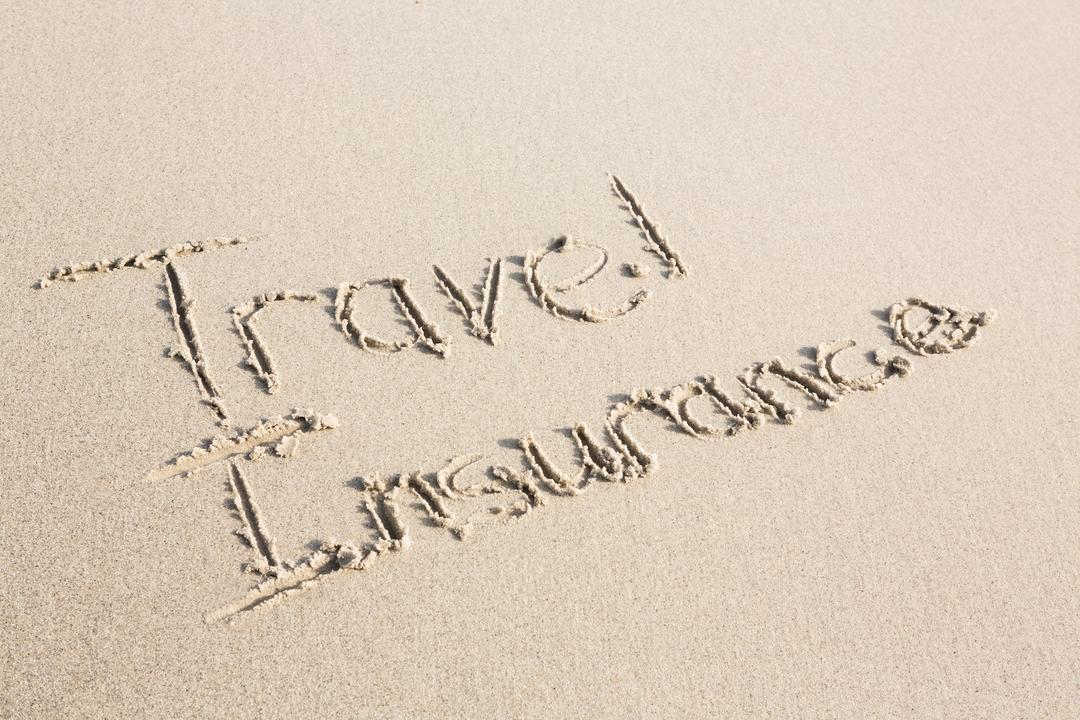 Travel Insurance written on sand at beach Free Stock Images from PikWizard