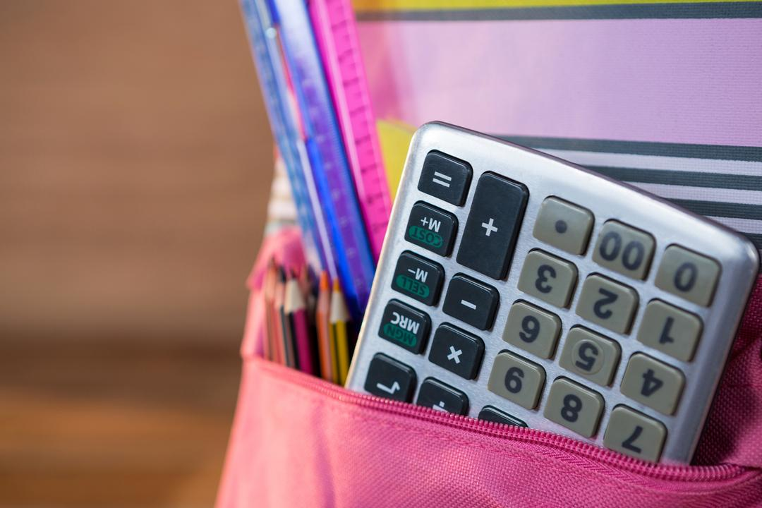 Close-up of calculator in school bag Free Stock Images from PikWizard