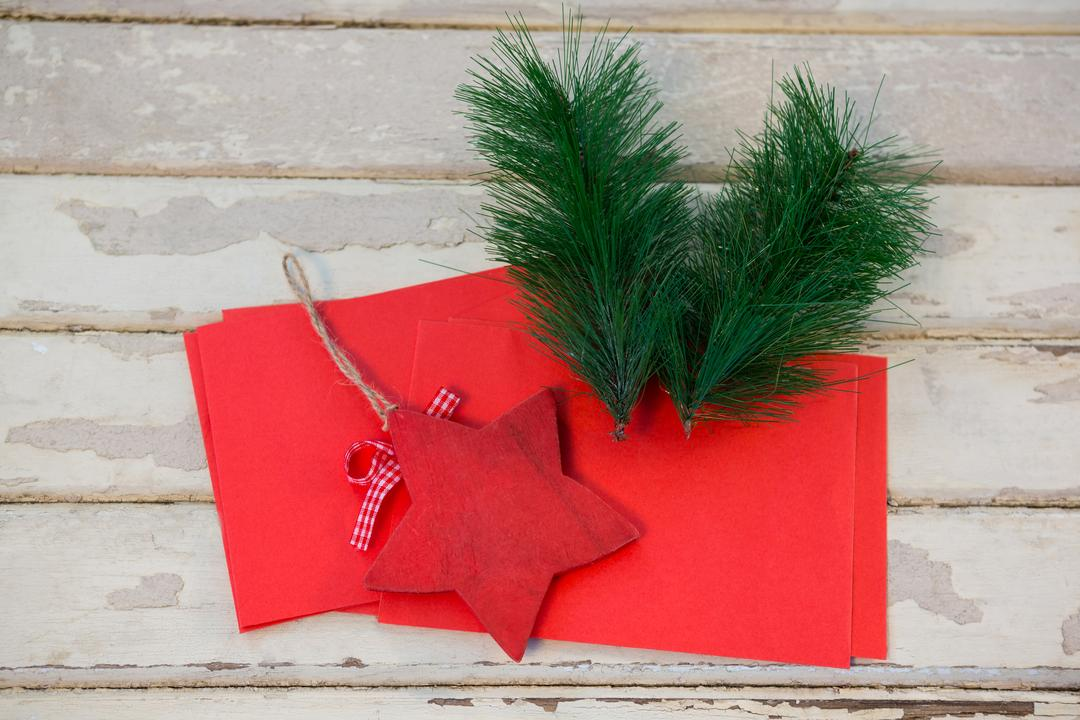 Red envelopes, christmas fir and star on wooden plank during christmas time