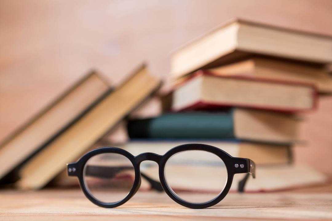 Close-up of spectacles on a wooden table