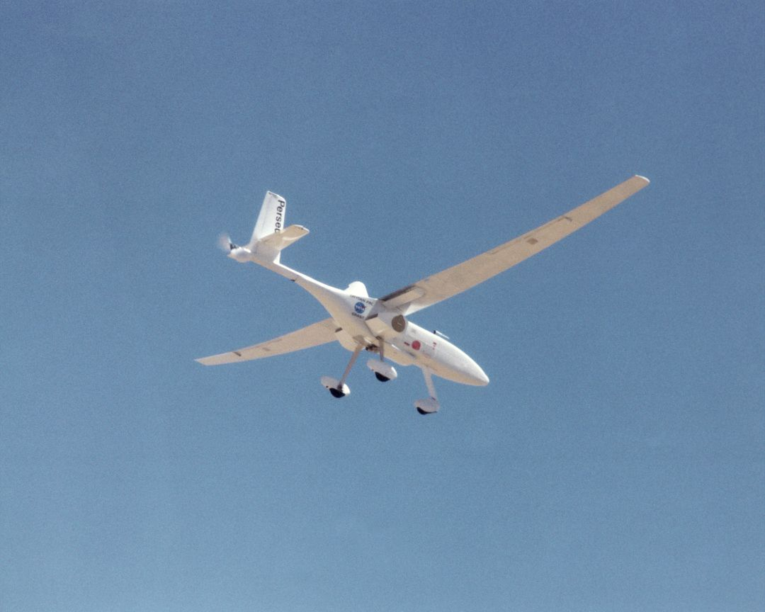 A long, slender wing and a pusher propeller at the rear characterize the Perseus B remotely piloted research aircraft, seen here during a test flight in June 1998.
