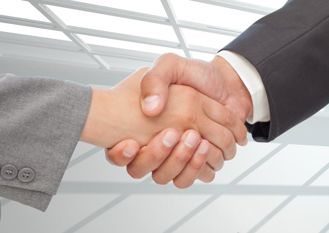 Digital composition of businessman shaking hands against office in background