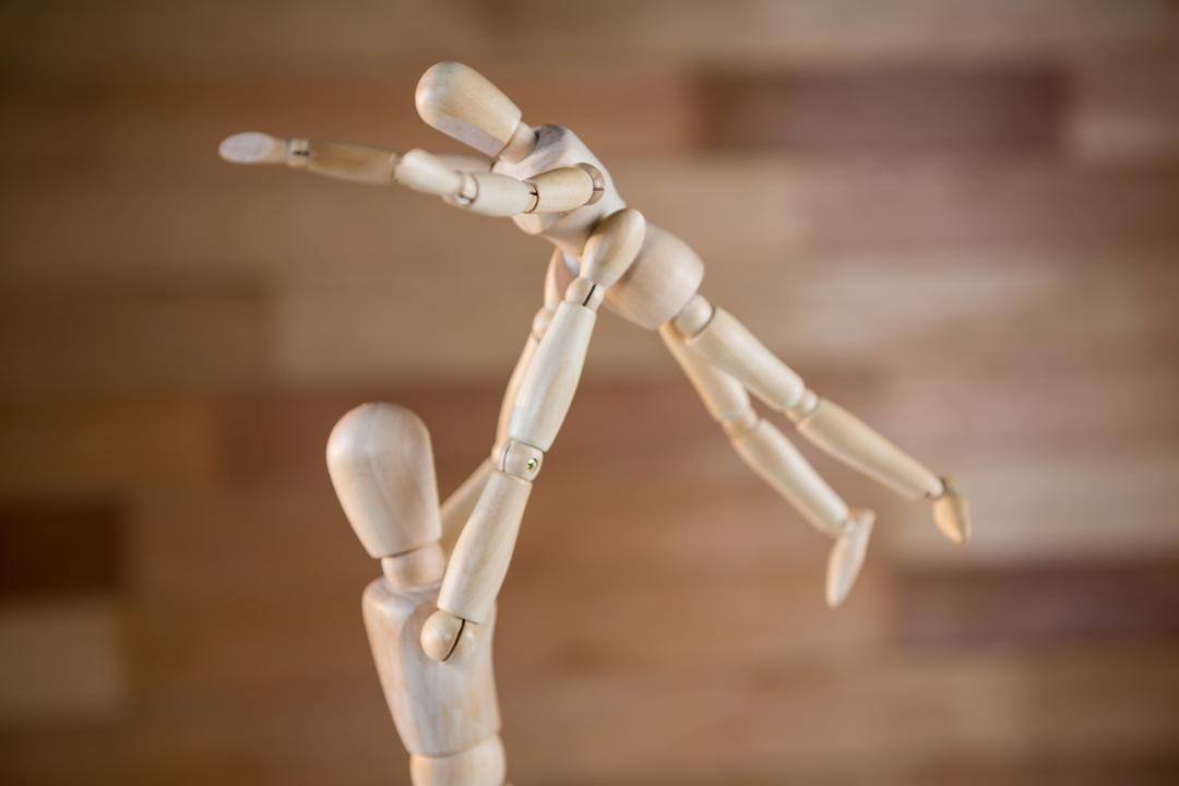 Conceptual image of figurine lifting baby figurine Free Stock Images from PikWizard