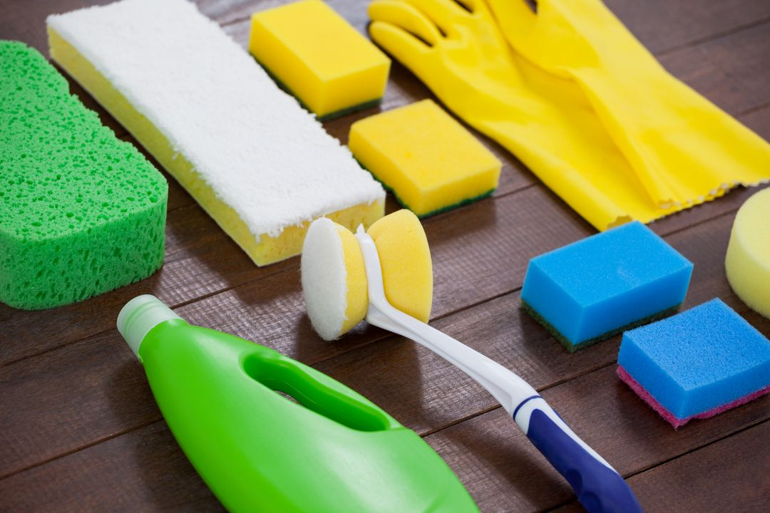 Set of cleaning equipment arranged on wooden floor Free Stock Images from PikWizard