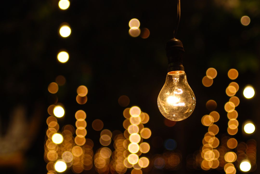 Wide image of a collection of lightbulbs with one in focus
