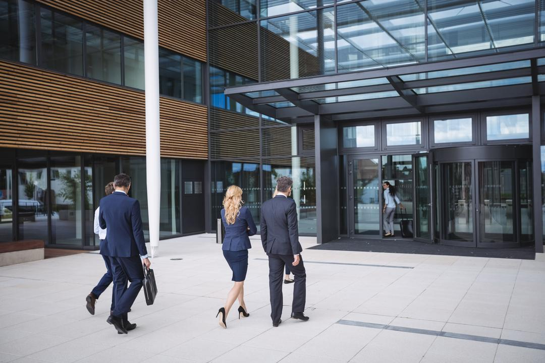 Group of business people entering into an office building Free Stock Images from PikWizard