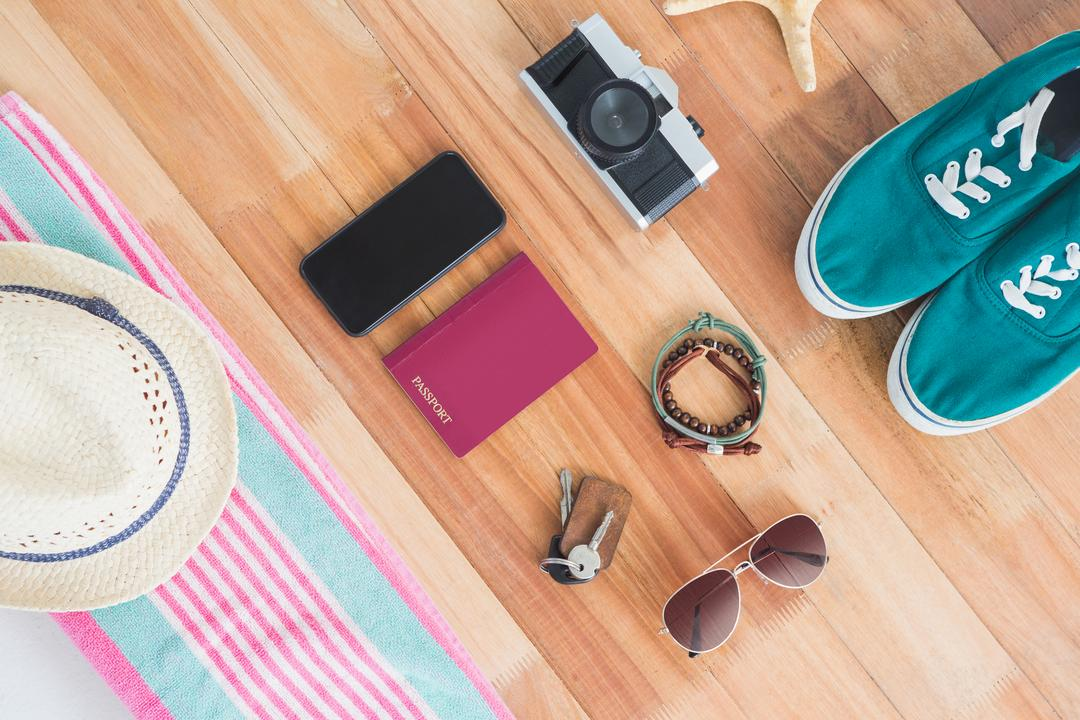 Various accessories and travel items on wooden board Free Stock Images from PikWizard