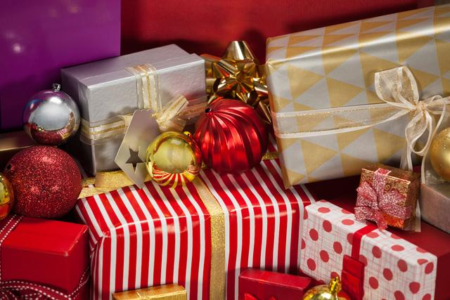 Close-up of wrapped gift boxes and baubles during christmas time