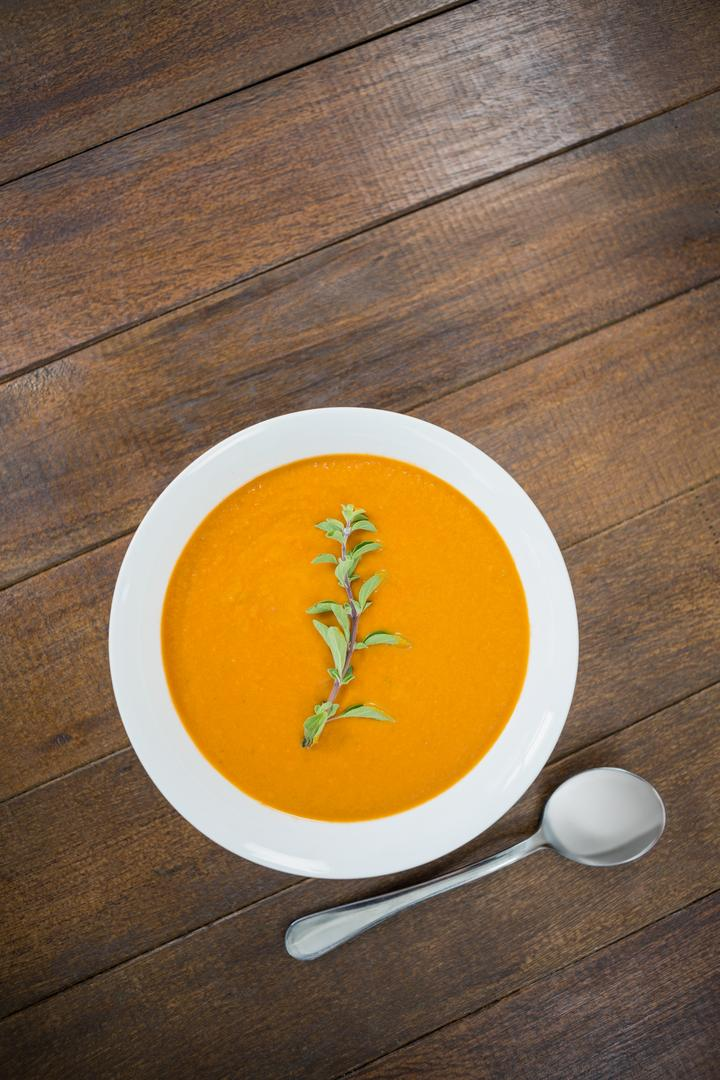 Bowl of pumpkin soup on wooden board Free Stock Images from PikWizard