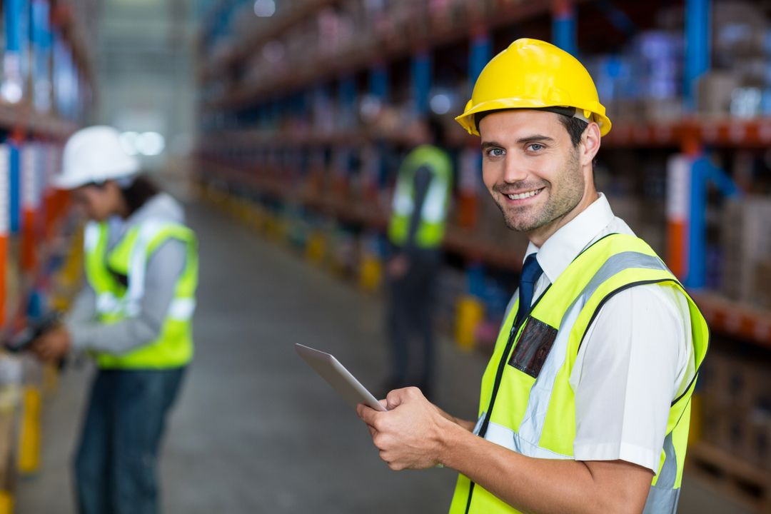 Portrait of warehouse manager holding digital tablet in warehouse Free Stock Images from PikWizard