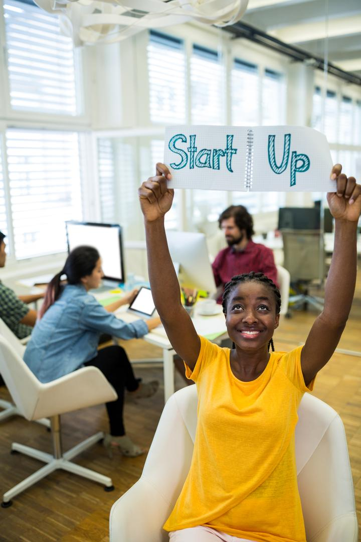 Female business executive start up sign in office