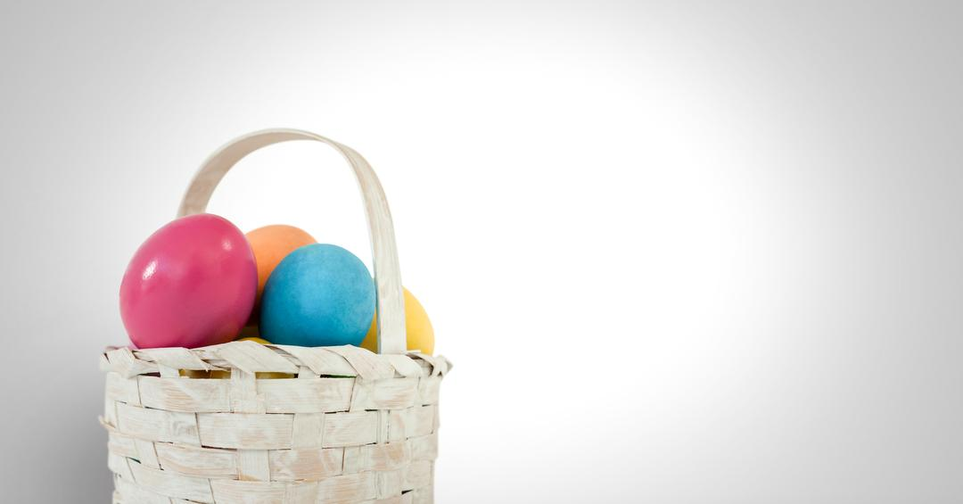 Digital composite of Easter eggs in basket in front of grey background Free Stock Images from PikWizard