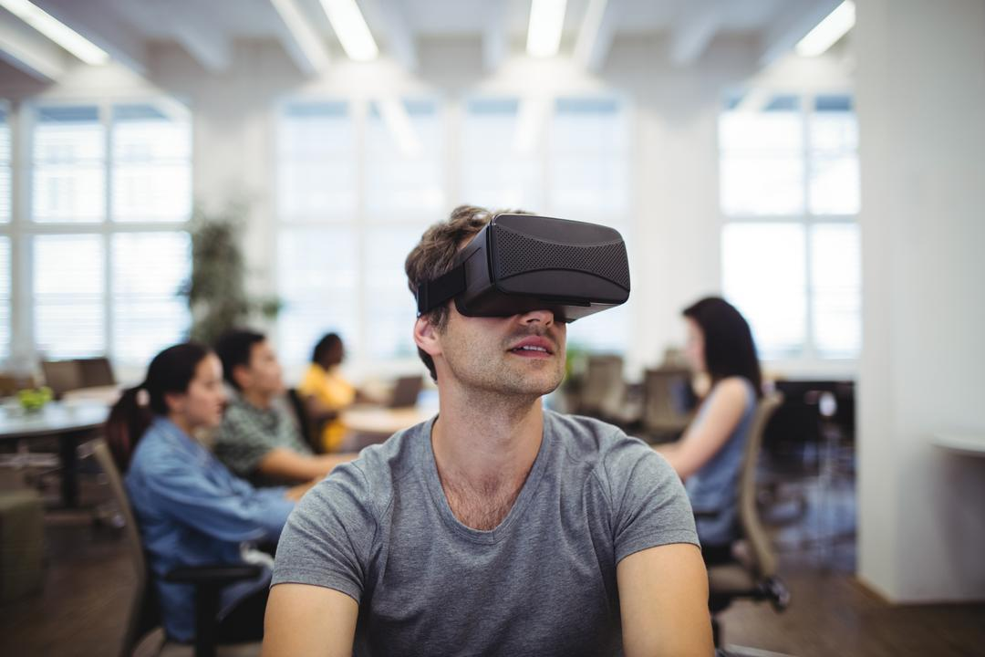 Man using virtual reality headset in the office