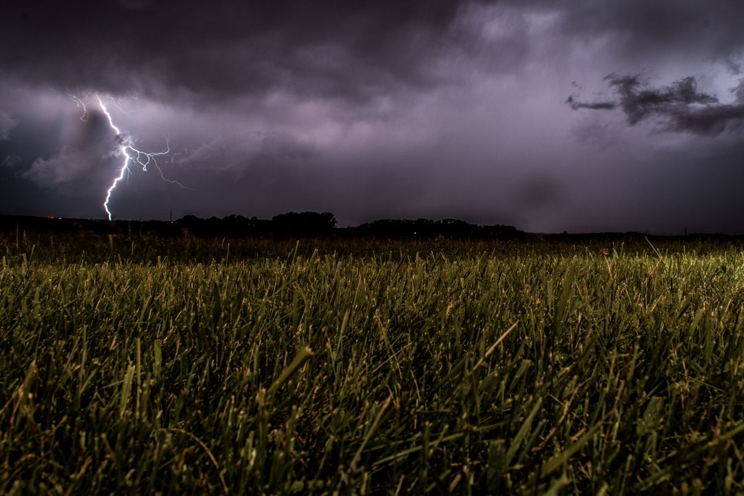 Green Fields during Night Being Struck by a Lightning