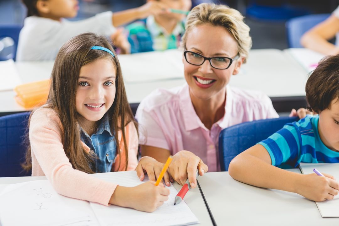 Image of a Teacher helping her Student