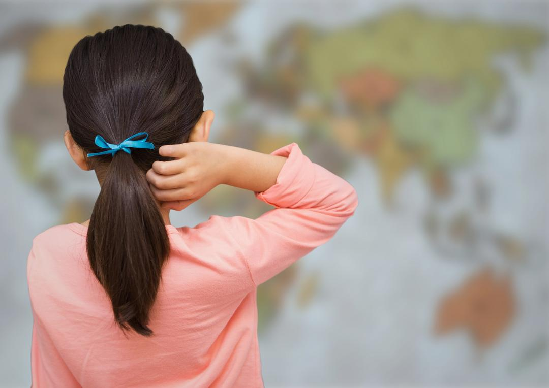 Digital composite of Back of girl with ribbon against blurry map Free Stock Images from PikWizard