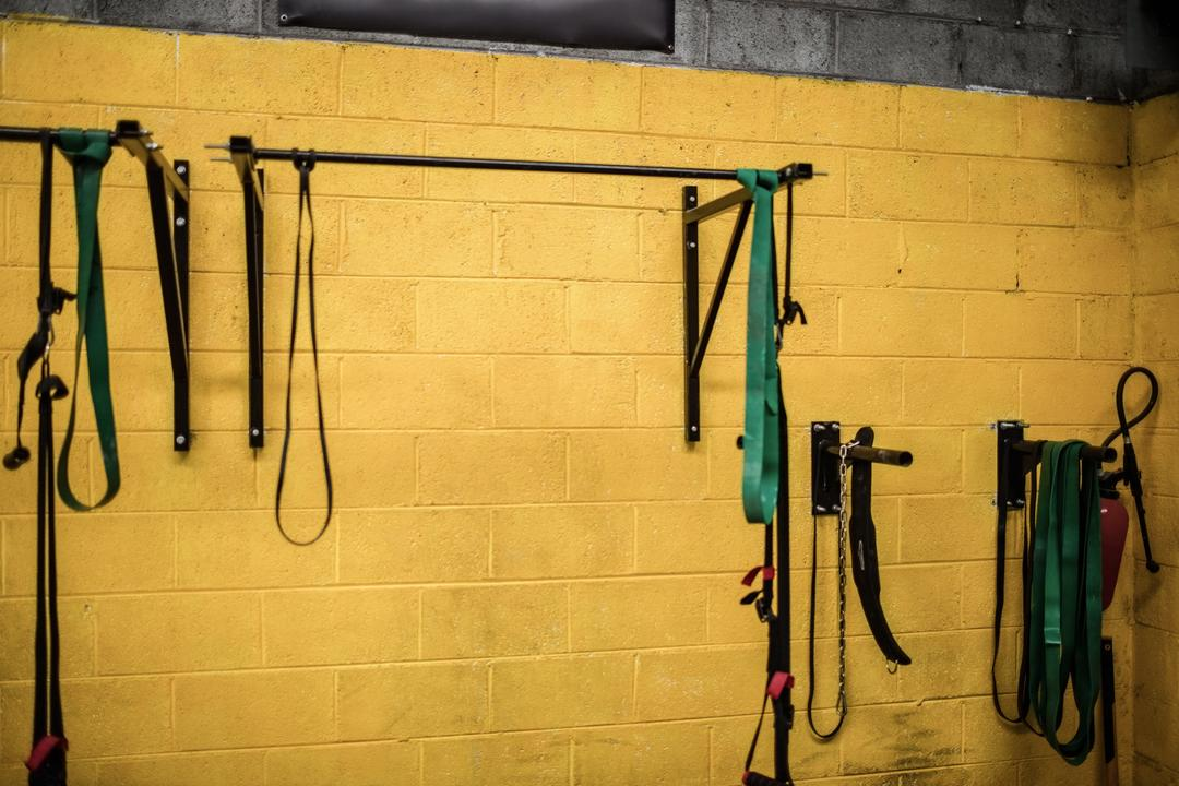 Resistance band hanging on rod in the fitness studio