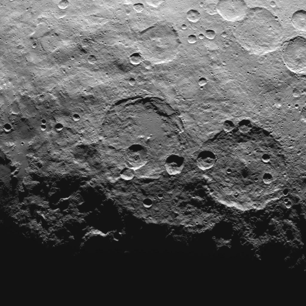 This image, taken by NASA's Dawn spacecraft, shows high southern latitudes on Ceres from an altitude of 2,700 miles (4,400 kilometers). The image, with a resolution of 1,400 feet (410 meters) per pixel, was taken on June 25, 2015. Zadeni crater, measuring about 80 miles (130 kilometers) across, is on the right side of the image.   http://photojournal.jpl.nasa.gov/catalog/PIA19634