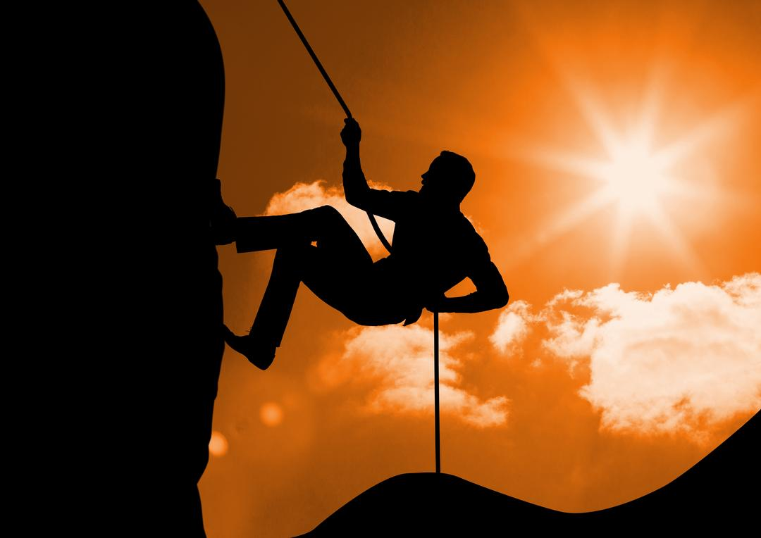 Digital composition of silhouette man climbing a mountain against sunny background