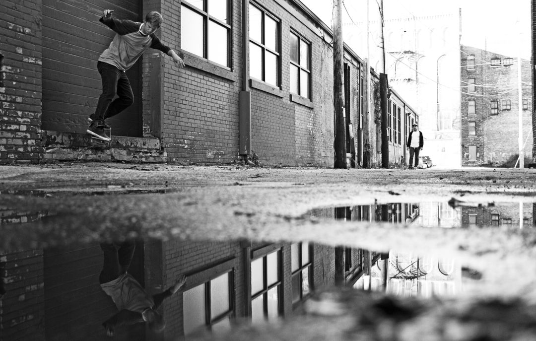 Alley puddle rain skate