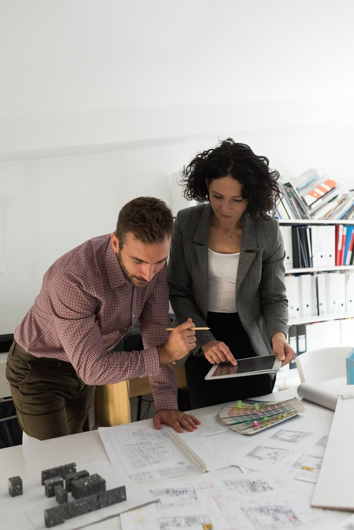 Male and female architects working together in the office Free Stock Images from PikWizard