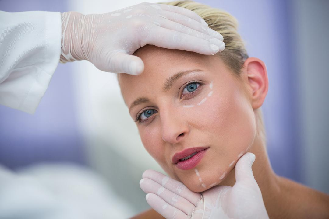 Close-up of doctor examining female patients face for cosmetic treatment Free Stock Images from PikWizard