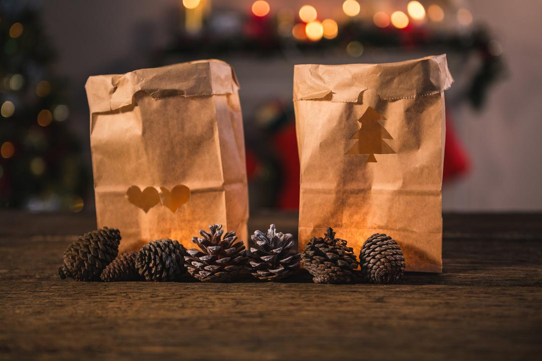 Paper bag and pine cone on wooden table Free Stock Images from PikWizard