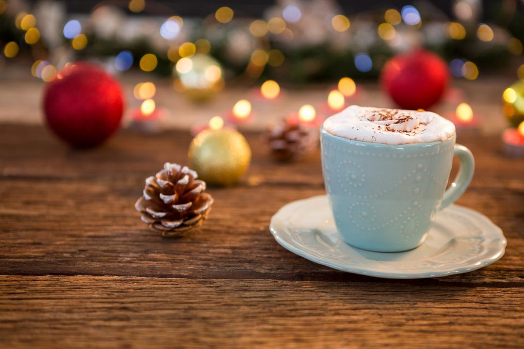 Cup of coffee with pine cone on wooden plank during christmas time Free Stock Images from PikWizard