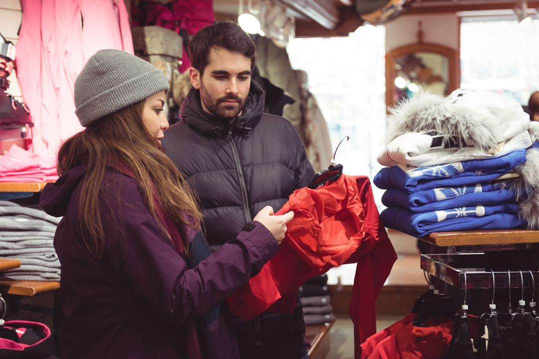 Couple looking at clothes in a store