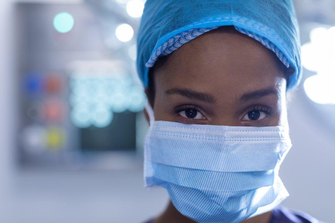 Young female surgeon standing in operation theater at hospital