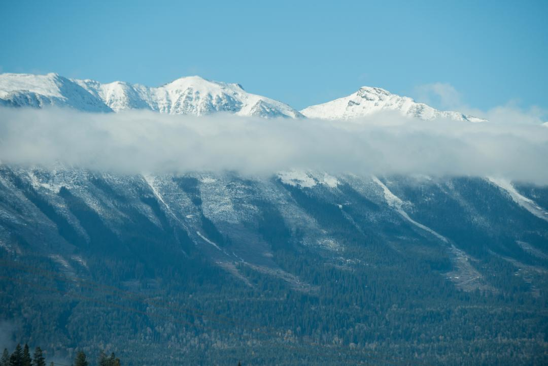 View of snowy mountain range against blue sky Free Stock Images from PikWizard