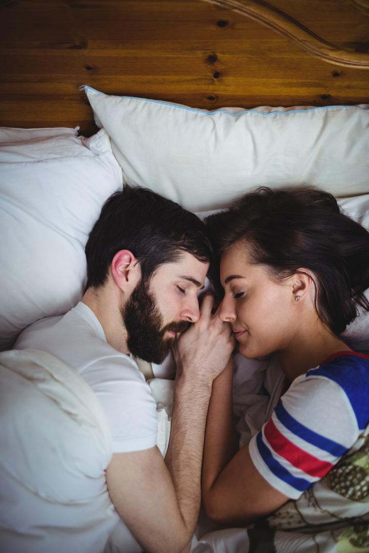 Couple sleeping together on bed at bedroom Free Stock Images from PikWizard