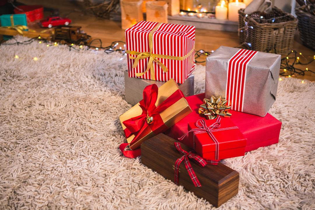 Close-up of wrapped gift on fur carpet in living room at home Free Stock Images from PikWizard