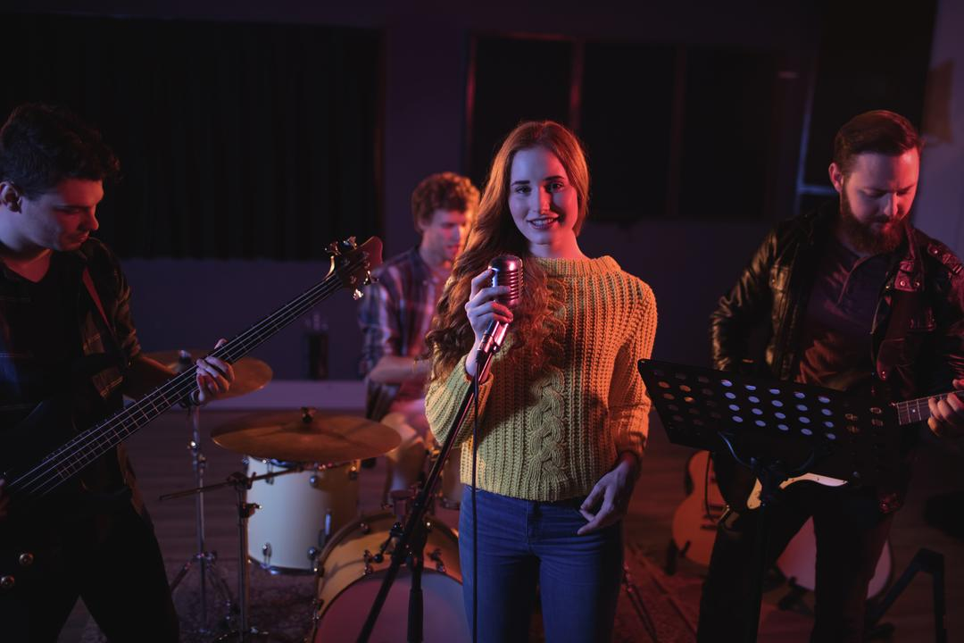 Band mates performing together in recording studio