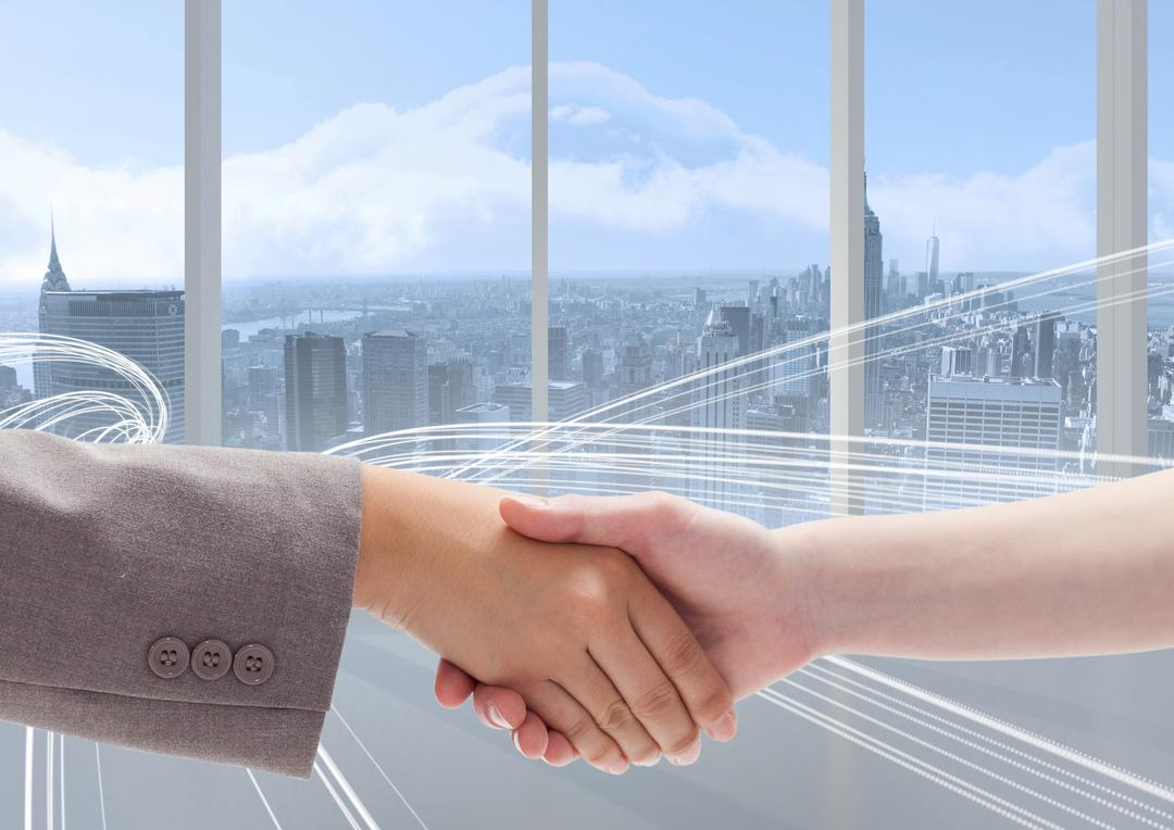 Digital composition of business executives shaking hands against cityscape in background Free Stock Images from PikWizard