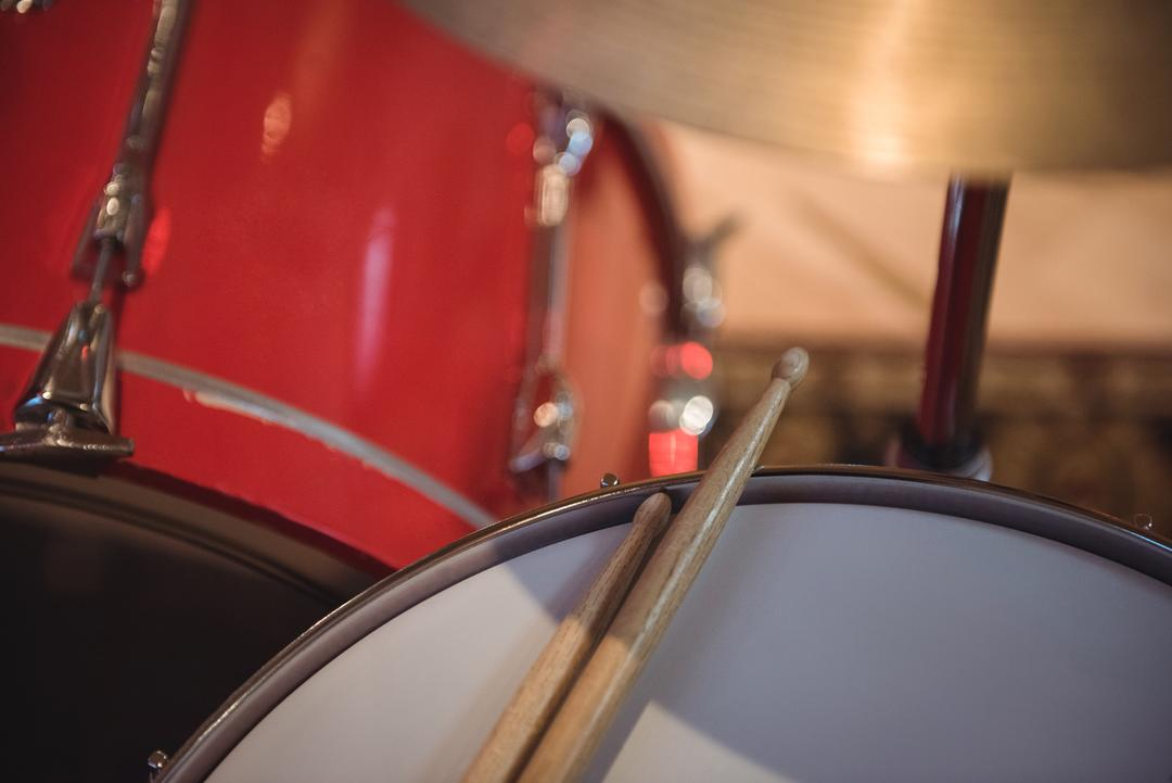 Close-up of snare drum with drum sticks in recording studio
