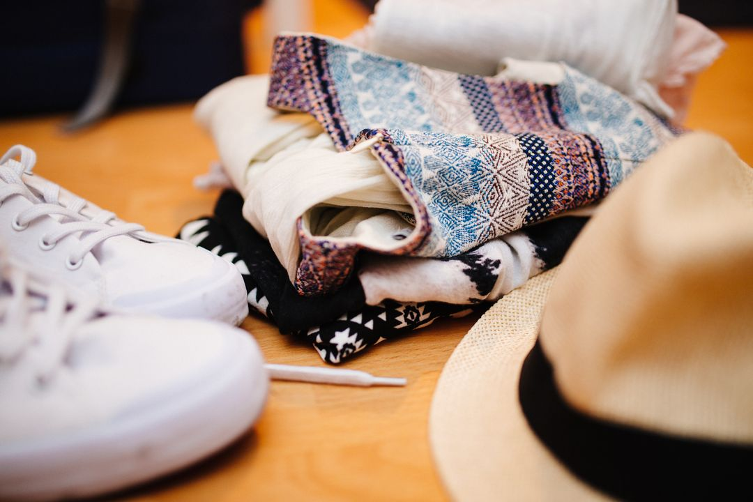 Image 23 How To Start A Fashion Blog - Folded clothes, shoes and hat.